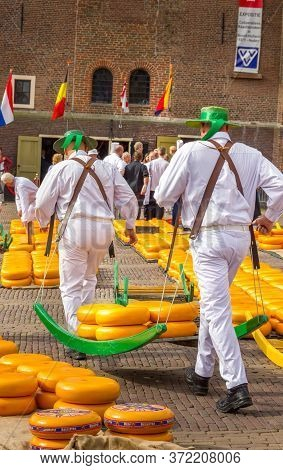Alkmarr, The Netherlands - 7 September, 2012: Carriers Walking With Many Cheeses In The Famous Dutch