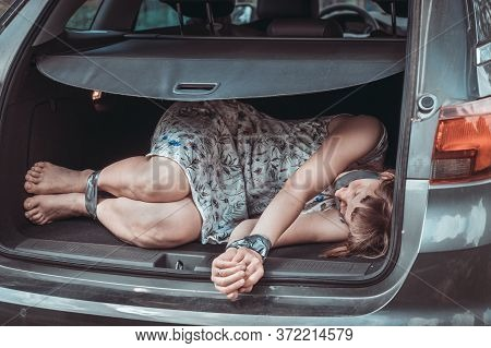 Woman With Tied Hands Inside Car Trunk - Kidnapping Concept