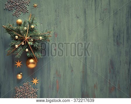 Metal Gilded Star Shape With Natural Fir Twigs And Golden Baubles, Trinkets And Shiny Sparkling Snow