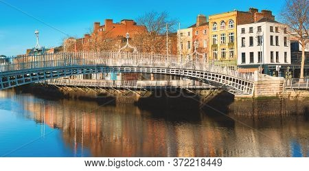 Dublin, Panoramic Image Of Half Penny Bridge, Or Hapenny Bridge, On A Bright Day With Beautiful Refl