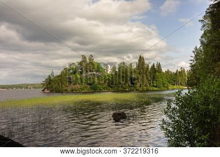 Magnificent Landscape. The Nature Of Karelia. View Of The Lake And Trees.