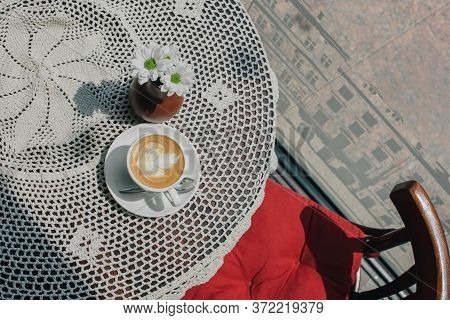 A Cup Of Hot Cappuccino On Table. Cappuccino Or Latte In The Early Morning In Sunlight. Coffee And C