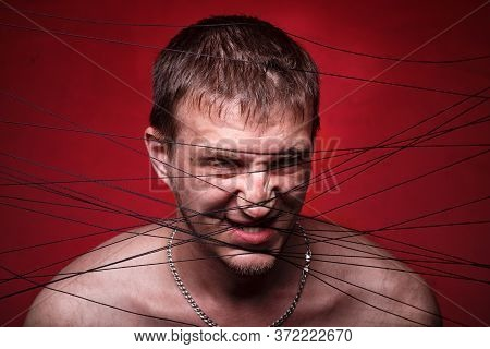 Photo Of Mad Man In Black Threads On Red Background