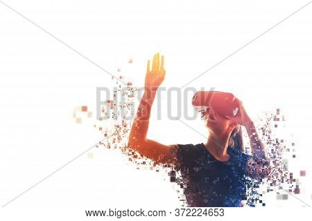 A Girl In Virtual Reality Glasses Is Pixelated Or Scattered Into Pixels. Vr Concept. Modern Technolo