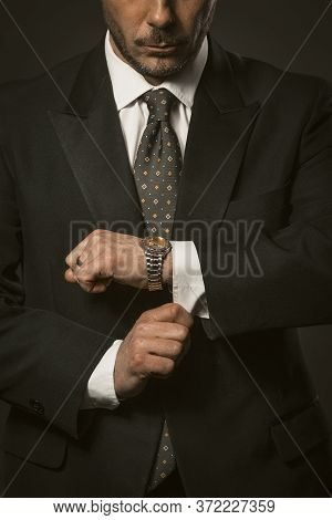 Businessman Checks The Time. Well-dressed White-collar Worker Bearded Caucasian Man Looks At Wristwa