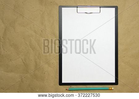A Tablet With A White Sheet Of A4 Format With Pencil On A Beige Craft Paper. Concept Of New Opportun