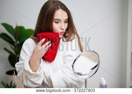Cleansing Facial Skin, Young Woman Holding Red Towel Near Facial Skin After Washing Face