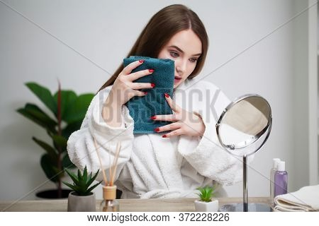 Cleansing Facial Skin, Young Woman Holding Towel Near Facial Skin After Washing Face