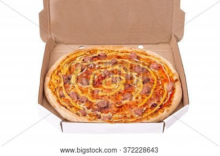 Delicious Pizza With Beef Sausages, Mozzarella, Various Sauces And Marinated Red Onions In Cardboard