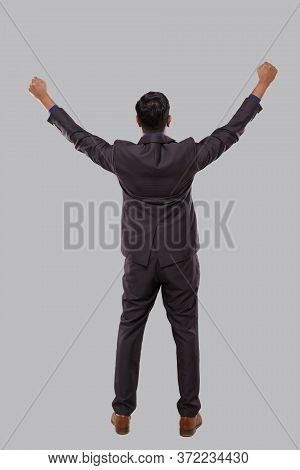 Businessman Very Happy And Excited, Raising Arms, Celebrating A Victory Or Success View From Back. W