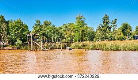 Lush Vegetation, Fishermen Boat By Wooden Pier. Tigra Delta In Argentina, River System Of The Parana