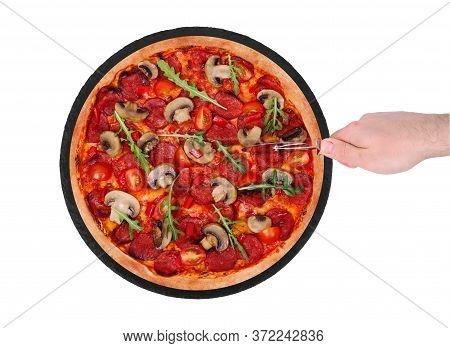 The Chef Cuts The Pizza Hot With A Pizza Cutter. Tasty Pizza With Salami, Arugula, Cherry Tomatoes,