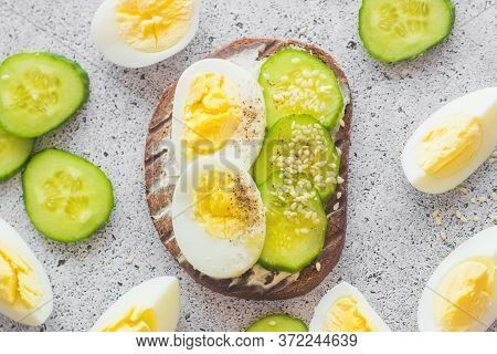 Sandwiches With Egg, Cucumber, Sesame Seeds And Spices. Tasty Breakfast. Sandwiches On The Table