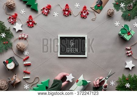 Creative Handmade Decor, Zero Waste Christmas Frame. Flat Lay, Top View On Craft Paper. Textile Trin