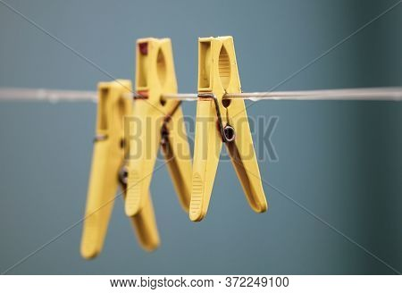 A Plastic Clothespin Hangs On A Clothesline.