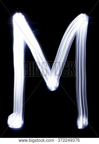 Handwrite Letter M, Made With Light Painting Technic Isolated On Black. Light Effect Font Of Full Al