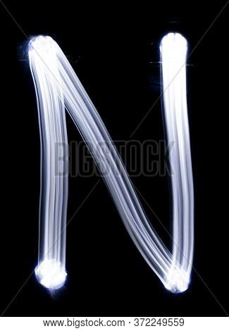 Handwrite Letter N, Made With Light Painting Technic Isolated On Black. Light Effect Font Of Full Al