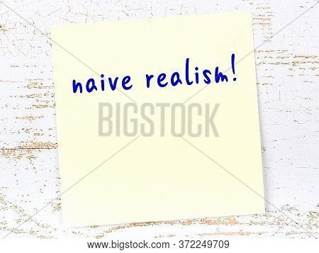 Yellow Sticky Note On Wooden Wall With Handwritten Inscription Naive Realism