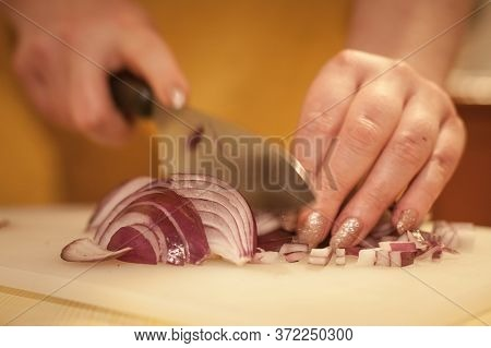 Women Hands Chopping Red Onions With A Knife, On A White Plank, With A Speed Blur And A Focus On The