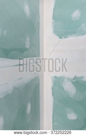 Background Of Dry Wall Made Of Gypsum Boards With Joints On Building Site