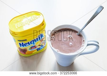 Moscow, Russia - June 16, 2020: Top View Of Closed Jar Of Nesquik And Mug With Hot Chocolate On Tabl