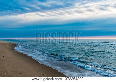 Picturesque Sunrise On The Ocean Beach. The Charming Landscape.