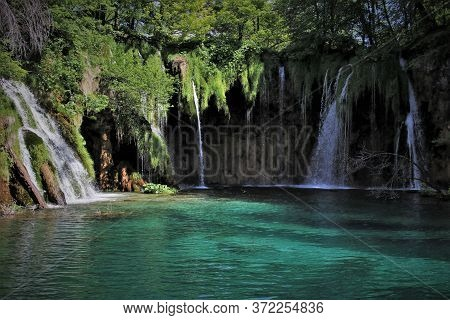A Picturesque Waterfall Cascade In An Idyllic Green Area. Plitvice Lakes In The National Park Of Cro
