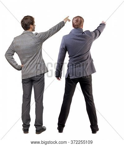 Back view of  business man and business woman in suit pointing. Business team. Rear view people collection. backside view of person. Isolated over white background.