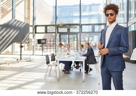 Blind business man with cane in business office for diversity and inclusion