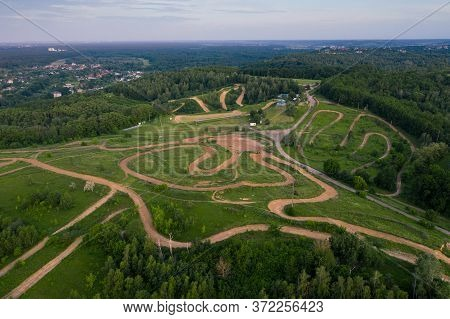 Location With Several Off-road Motorcycle Tracks For Competitions And Training. Dirt Track With Hill