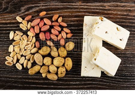 Peeled Fried Peanut, Raw Groundnuts, Peanuts In Shell, Pieces Of Nougats With Peanut On Dark Wooden