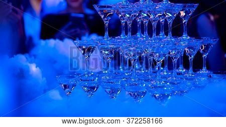 Many Glasses On A Table With Alcohol And Without With Liquid Nitrogen