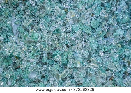 Broken Glass As Background. A Lot Of Fine Shards And Pieces Of Shattered Glass