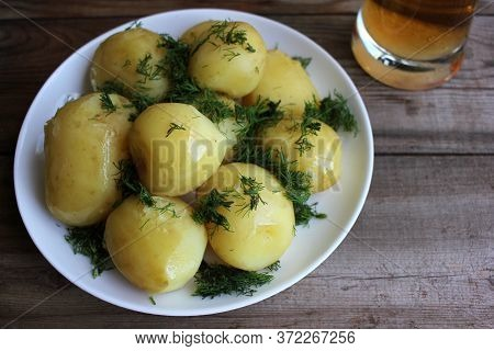 Traditional Swedish Midsummer Food Boiled Potatoes With Dill And Chopped Onion And Light Beer On The