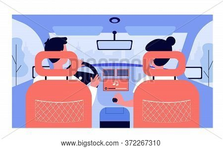 People Listening To Music While Travelling By Car. View From Backseat Of Couple On Passenger And Dri