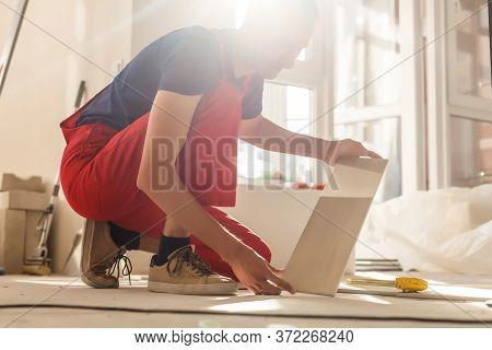 Home Improvement, Renovation - Construction Worker Tiler Is Tiling, Ceramic Tile Floor Adhesive