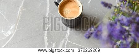 Coffee Drink And Flowers On A Marble Table In Home Interior