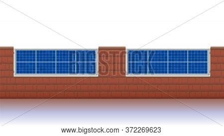 Photovoltaic Fence. Solar Panels For Ecological Electricity Production. Brick Wall With Solar Plates