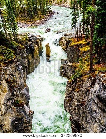 Water Of The Sunwapta River Tumbling Over The Edge Of Sunwapta Falls Before It Joins The Ayjabasca R