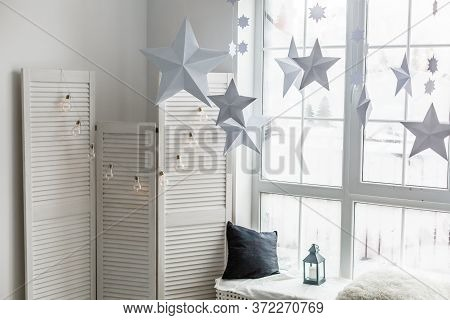 Large Bright Window. On The Window-sill Is A Gray Knitted Plaid With Gifts And Sparkles With Herland