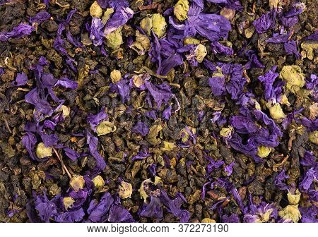 Tie Guan Yin Tea With Mallow Flowers. Organic Tea Background. Top View. Close Up.