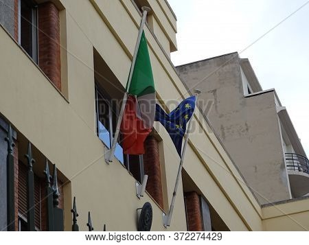 Italian And European Comunity Flags In A Public Building In France
