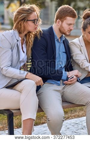 young couple looking carefully and interested content on laptop of caucasian colleague. cropped image