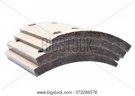 Stack Of Asbestos-cement Bases For Brake Pads Of A Truck Without Pads Stacked On Top Of Each Other O