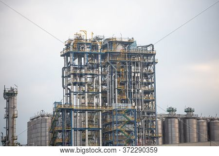 Pipeline System Of An Oil Refinery Or Factory. Chemical Refinery. Structure Of Tanks For Oil Storage