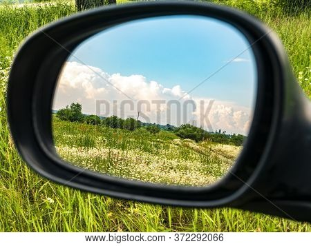Cloudy Blue Sky Landscape In A Car Rearview Mirror. Natural Landscape Blue Sky. Admire The View. On