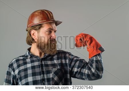Bearded Builder In Hard Hat. Serious Workman In Hard Hat. Builder Concept. Building, Industry, Techn