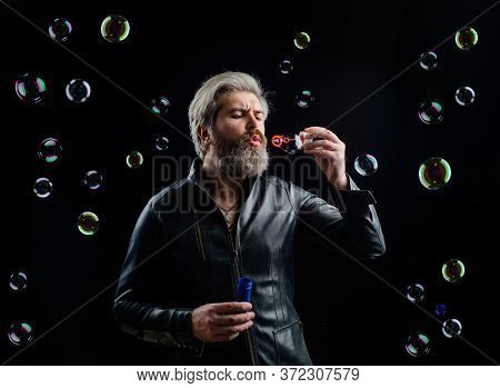 Man Blowing Bubbles. Soap Bubbles. Play With Bubbles. Bearded Man Blowing Soap Bubbles. Happiness. G