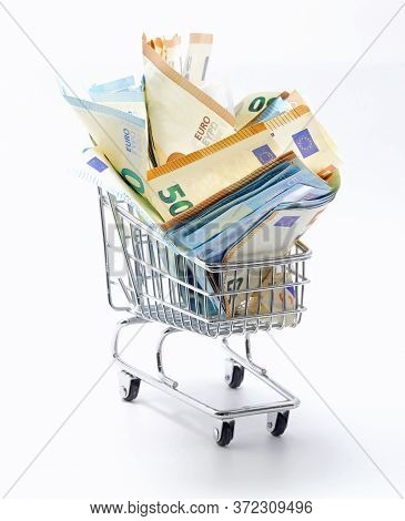 Many European Banknotes On A Shopping Cart Symbol Of Inflation On White Background
