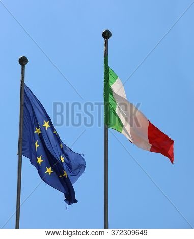 Blue European Flag With Yellow Stars And The Italian Tricolor Flag